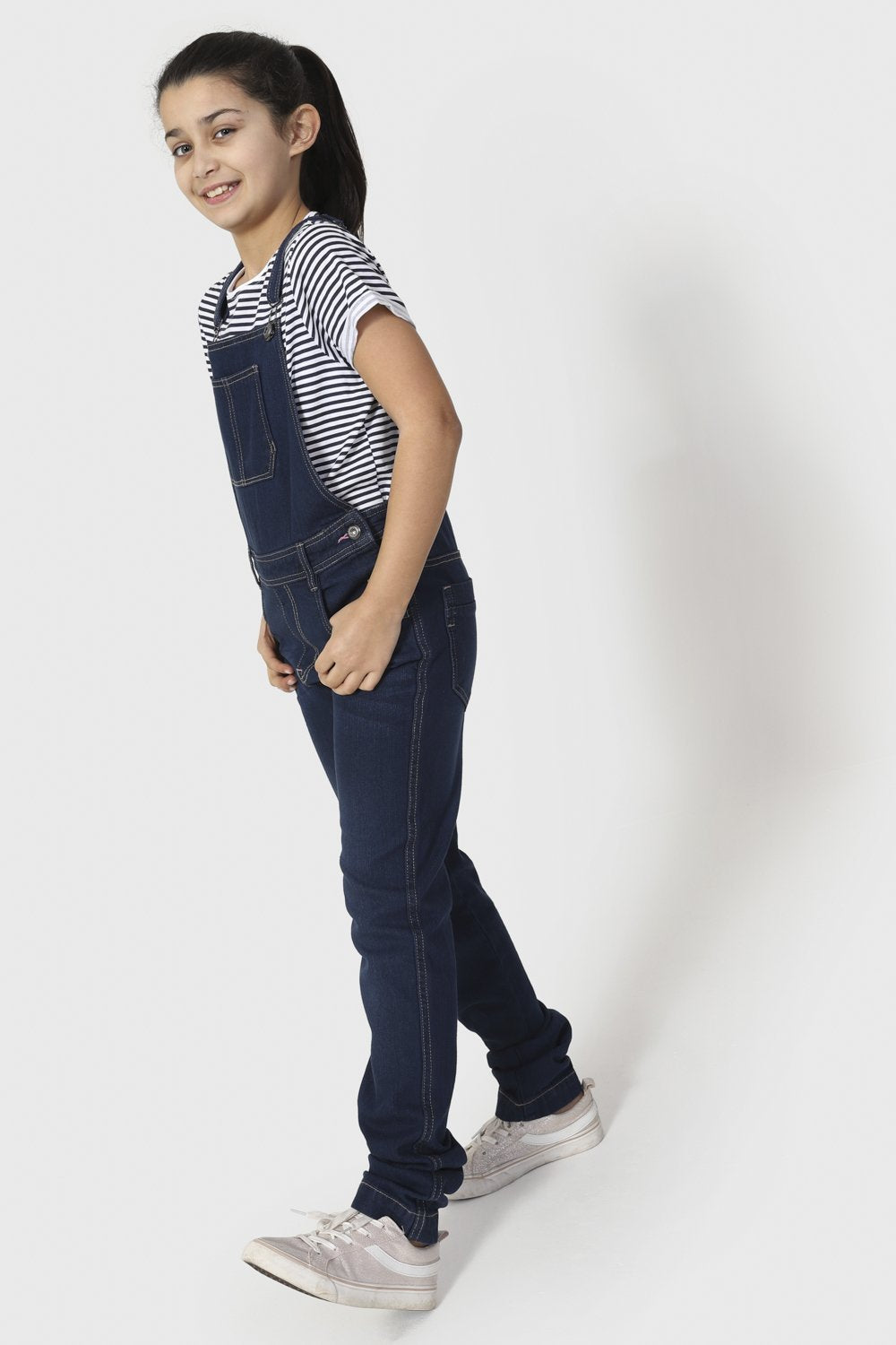 Full length front-side view of indigo denim, active girls, dungarees.