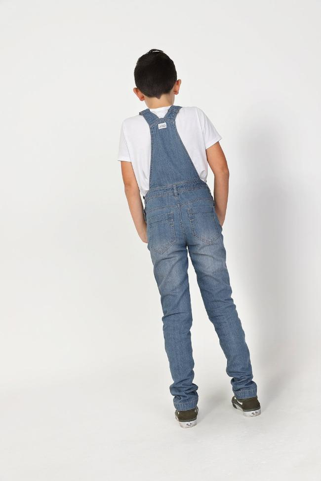 Full rear pose wearing modern style dungarees showing adjustable straps and belt loops.
