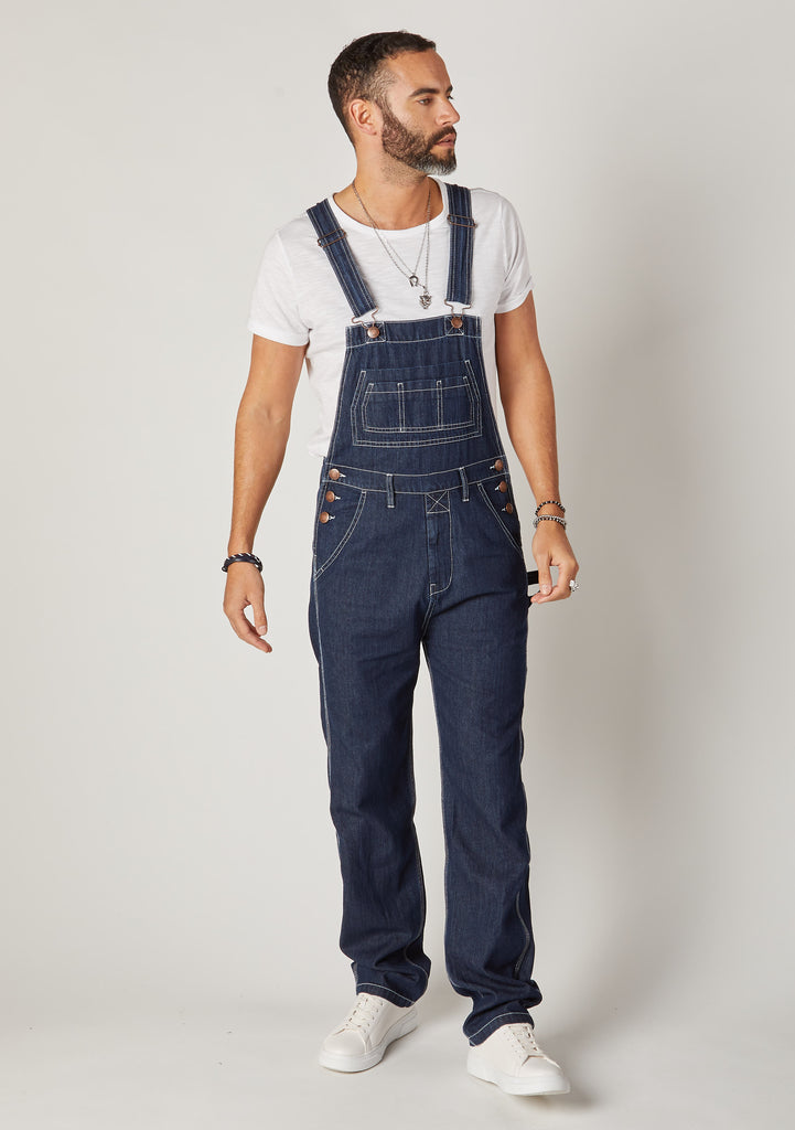 Front full-length pose Maddox dark blue denim loose fit dungarees for men.