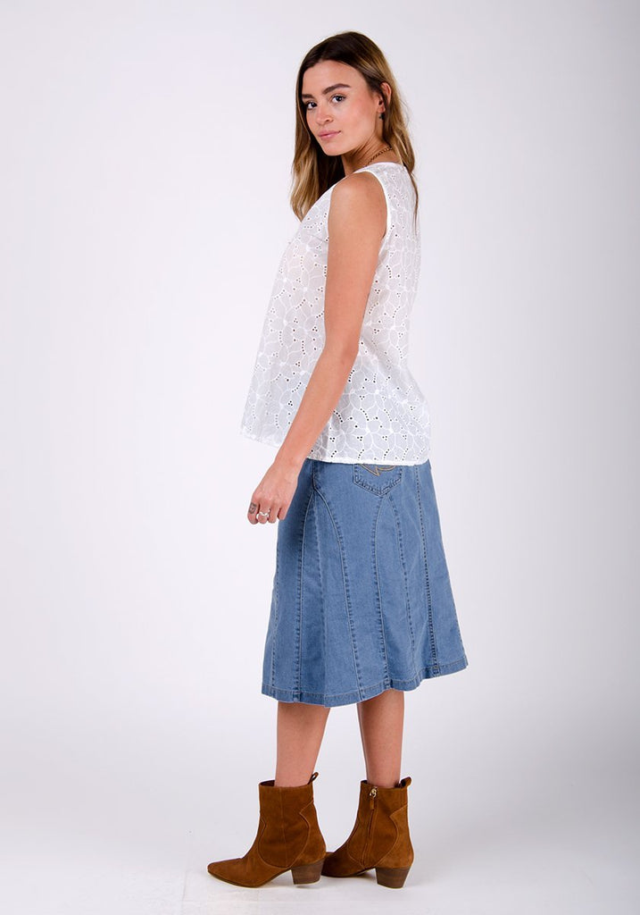 Full rear-side pose wearing pale wash, soft panelled denim skirt.