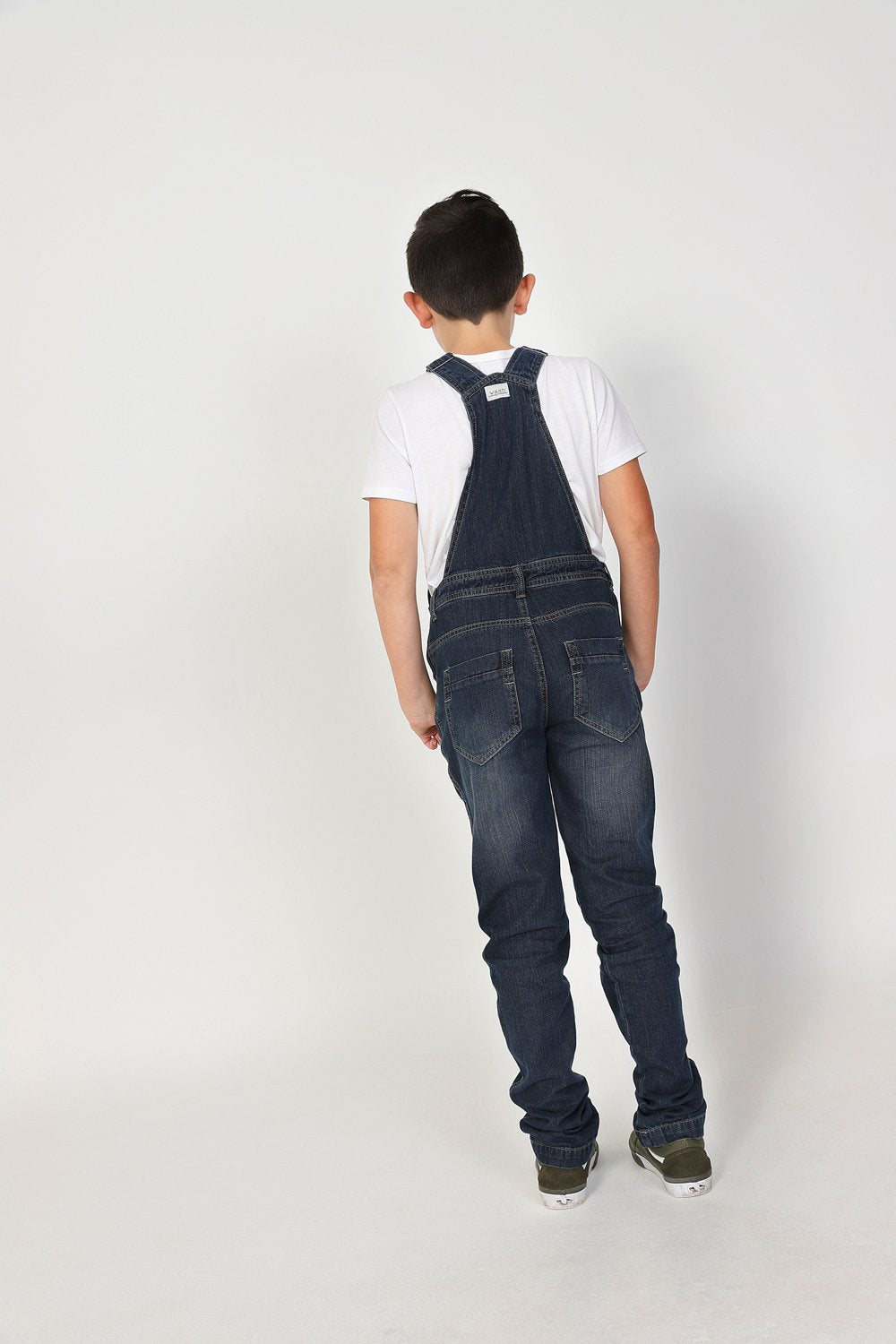 Full length, slightly angled view of dark denim, active kids, dungarees.