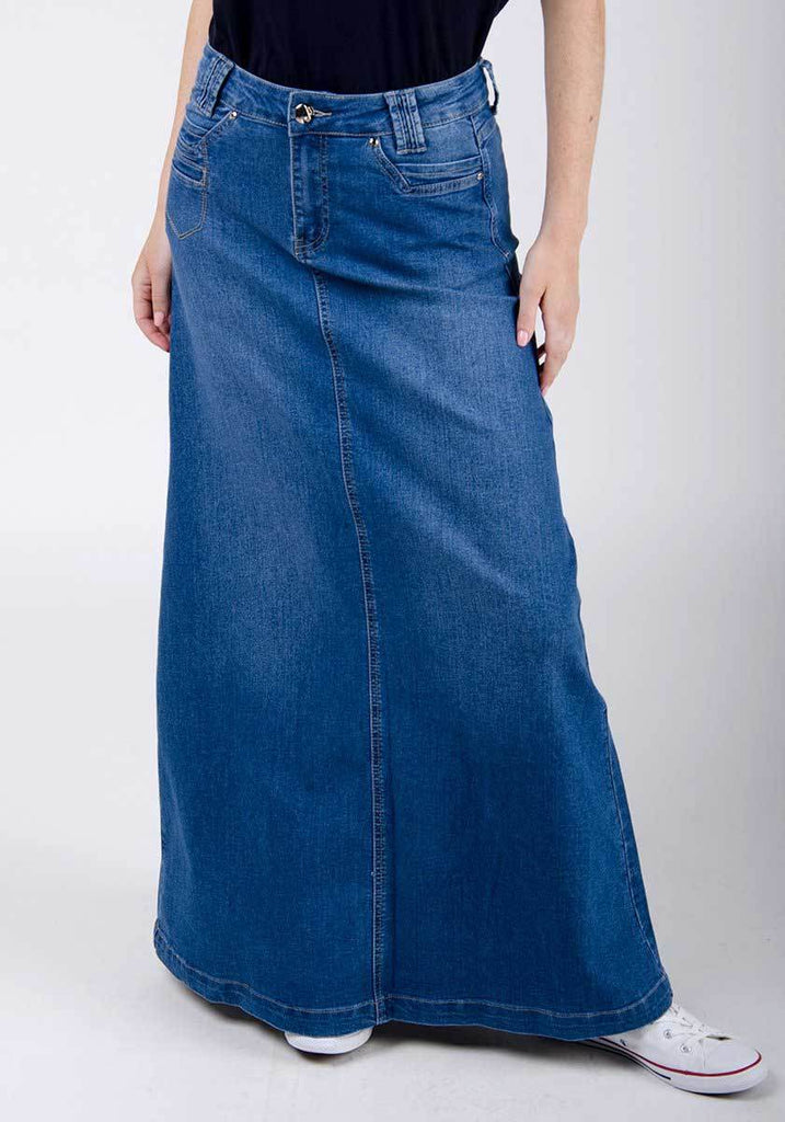 Half-frontal pose highlighting soft, stretch denim texture with flared hemline.