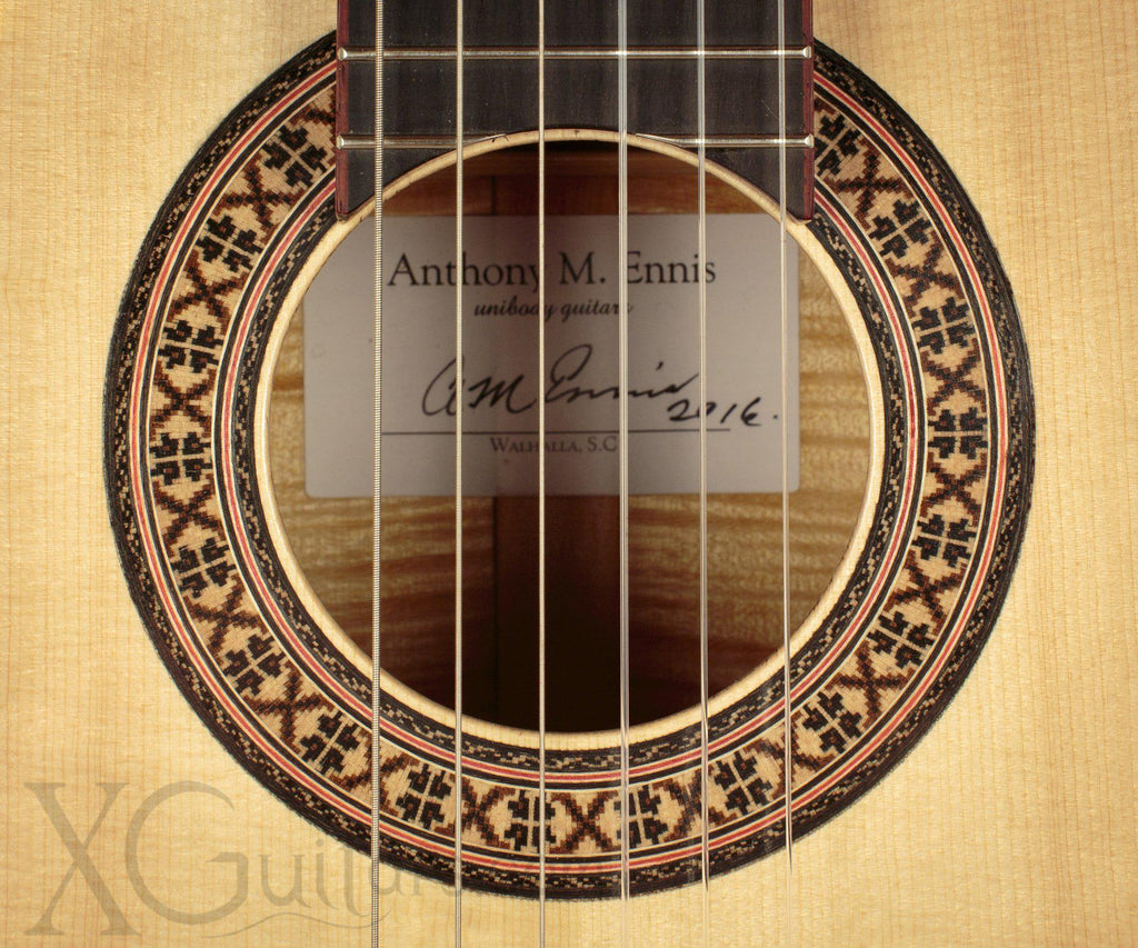 Tony Innis spruce top classical guitar headstock