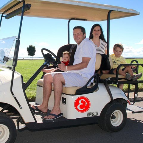 family outing on golf cart