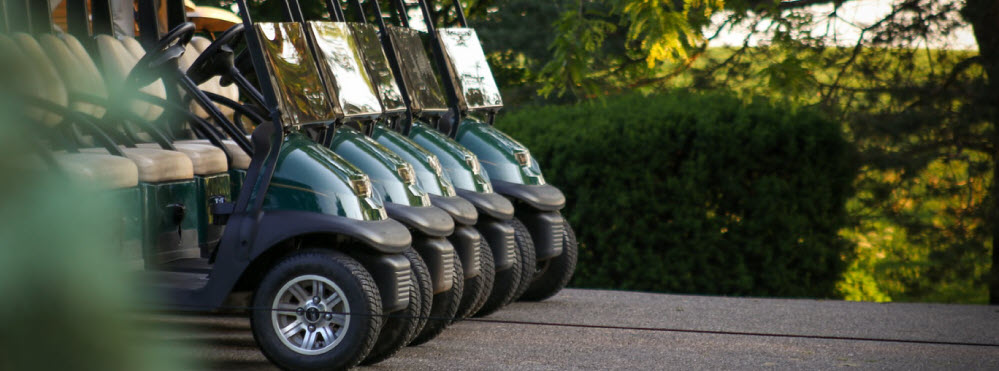 golf carts parked banner