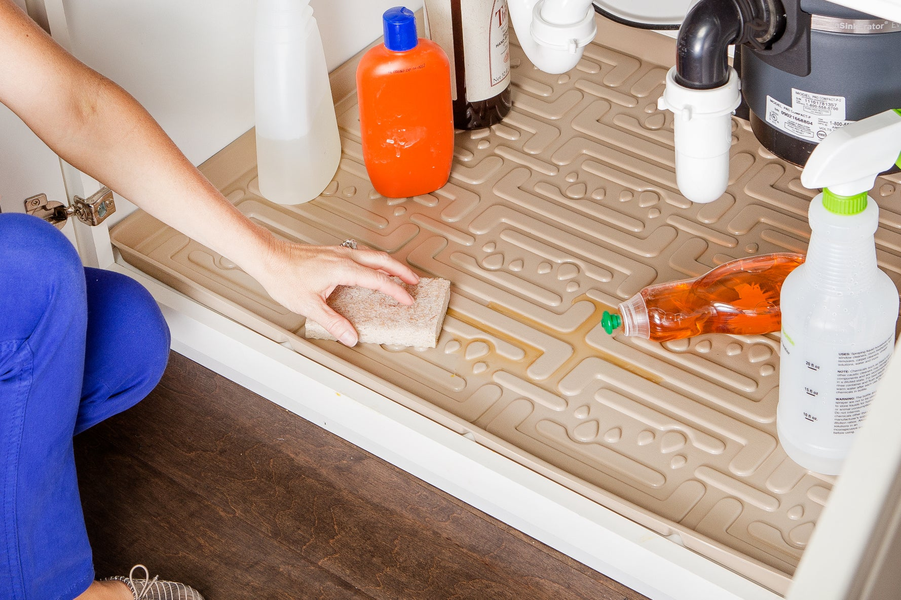 beige mat in a cabinet with bottles