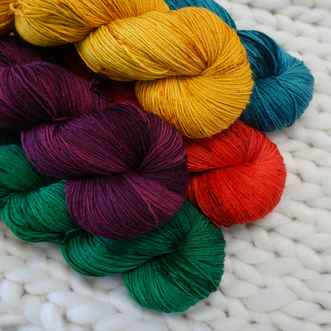 hand dyed yarn colors blue mustard green plum scarlet teal