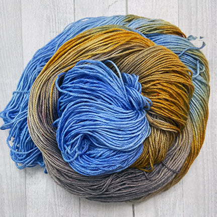 take it easy hand dyed yarn from the woolly dragon blue rust and brown