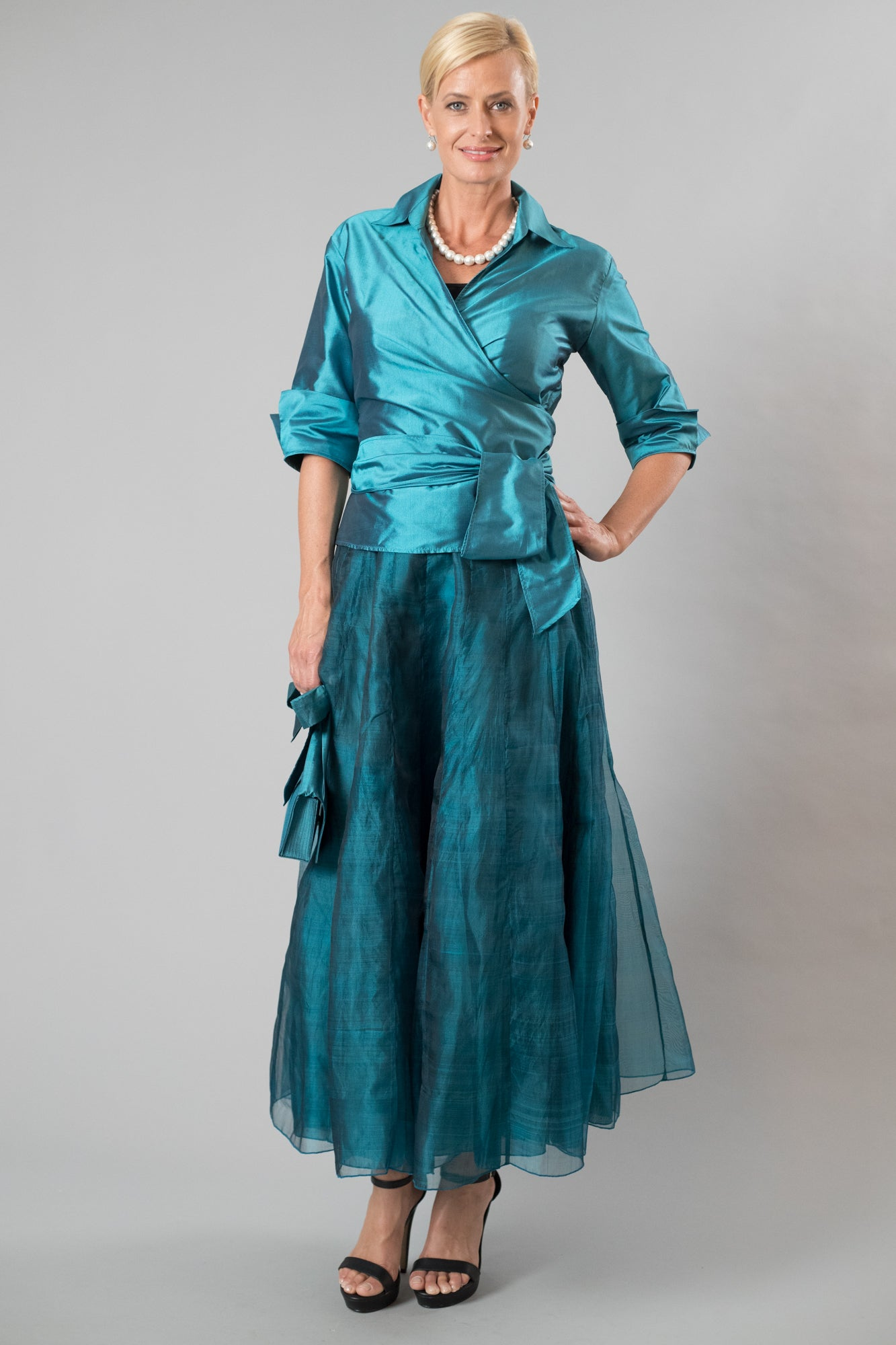 54de2370346 Teal two piece outfit for the modern and elegant mother of the bride  groom