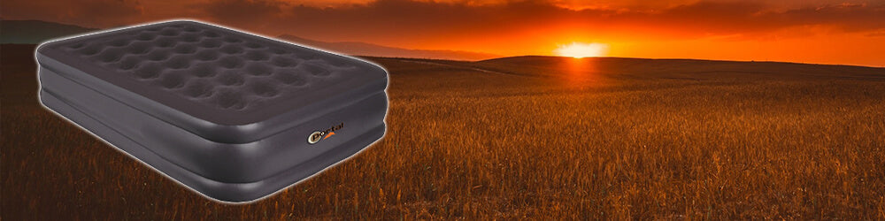 Portal Outdoor King Size Air Bed in front of Sunset Background.