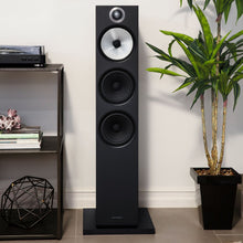 Load image into Gallery viewer, Black 603 floorstanding speaker next to plant in a living room