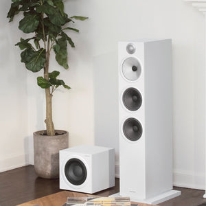 White ASW610 subwoofer next to white floorstanding 603