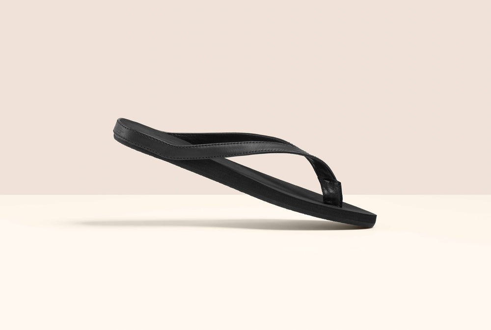 Mon Fred cover photo of a black flip flop