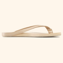 Side view of a beige Mon Fred flip flop
