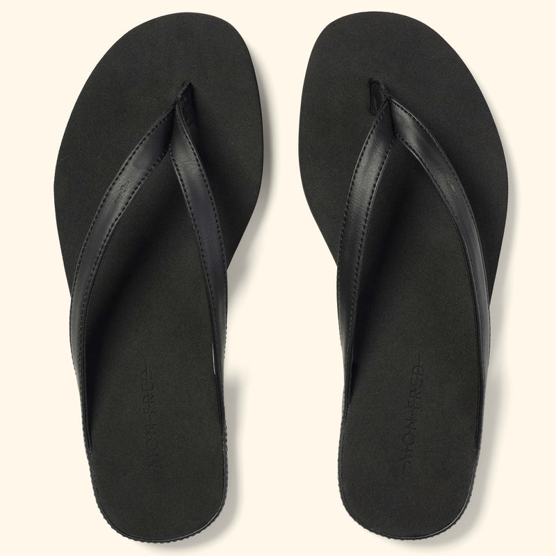 Top view of a a pair of black Mon Fred flip flops
