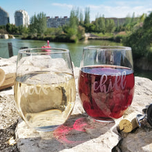 Netflix and Chill Funny stemless wine glasses with red wine and white wine on rock wall near blue lake in city with flip flop and wine corks and wine key