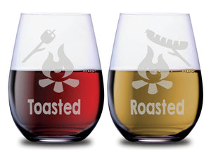 Toasted marshmellow over camp fire graphic and Roasted hot dog over camp fire graphic on stemless SMOOCHIES couples wine glasses filled with red and white wine | SMOOCHIES