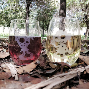 Fun Zombie male and zombie female stemless wine glass set etched with red wine and white wine in woods on a pile of leaves