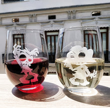 Fun Zombie male and zombie female stemless wine glass set etched with red wine and white wine in city window on wood table top