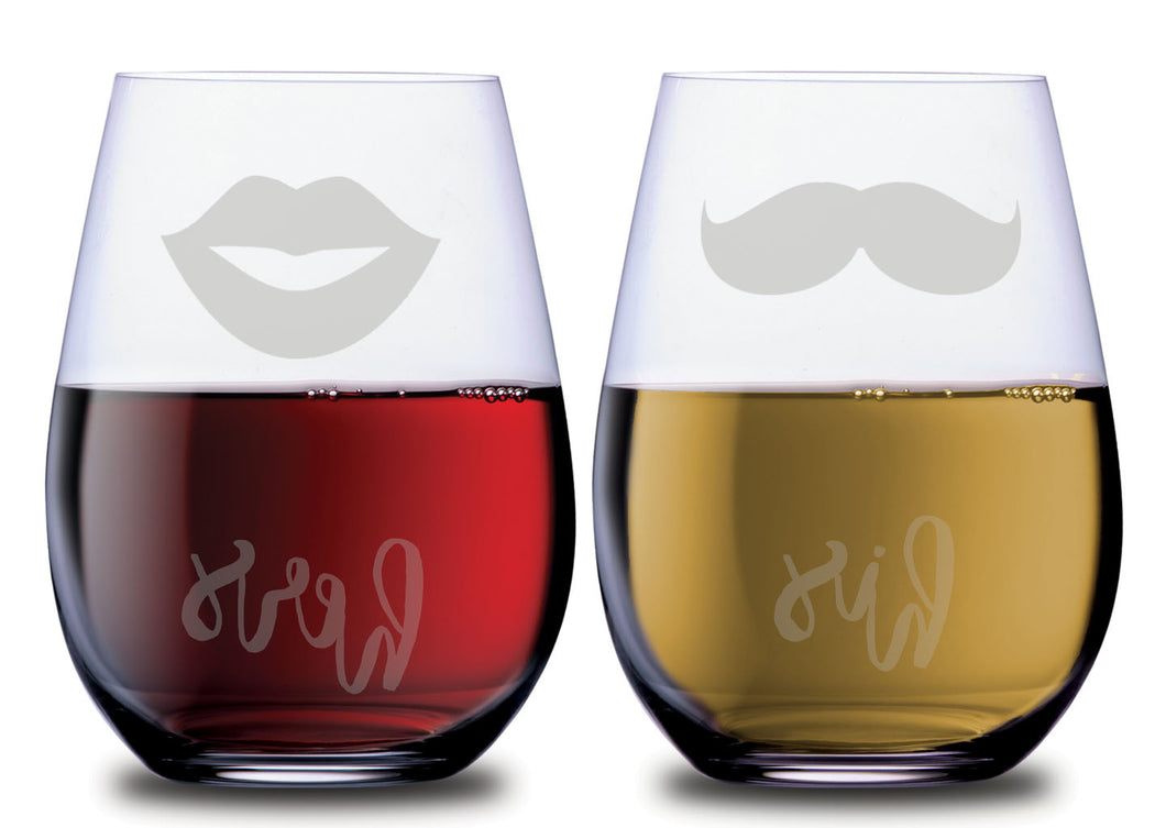 Stemless wine glasses with lips and mustache on front with his and her on back filled with red wine and white wine.