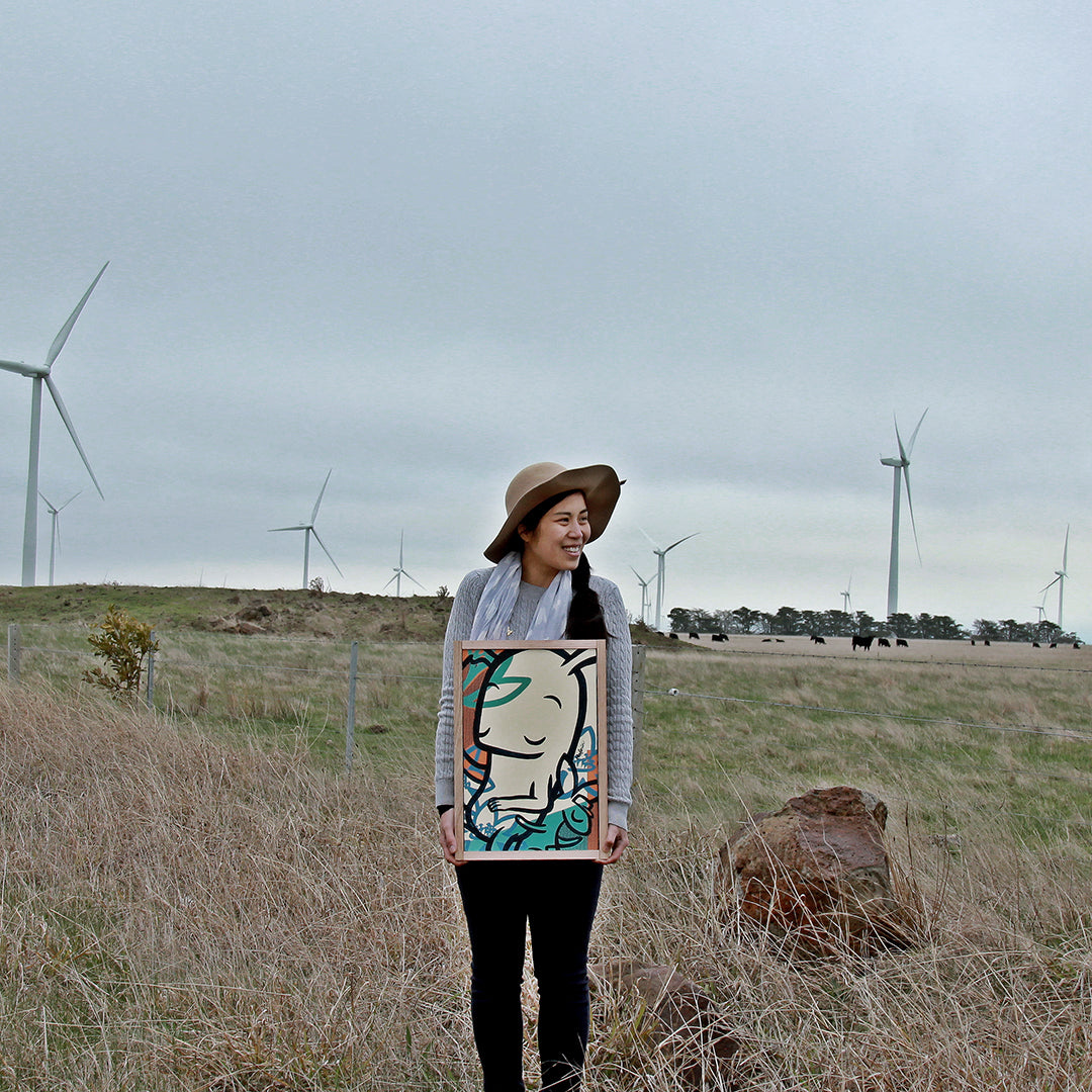 australian artist noferin holding painting renewable energy windfarm mount mercer, near ballarat
