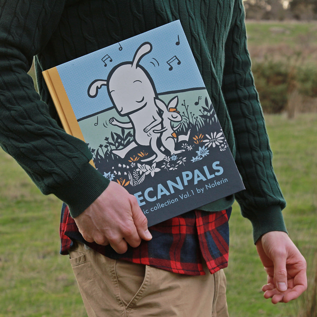 noferin holding comics outdoors