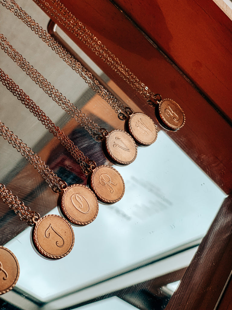 MEDALLION INITIAL NECKLACES