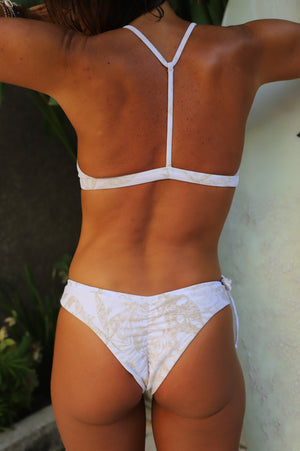 Tropical white gold surf bikinis