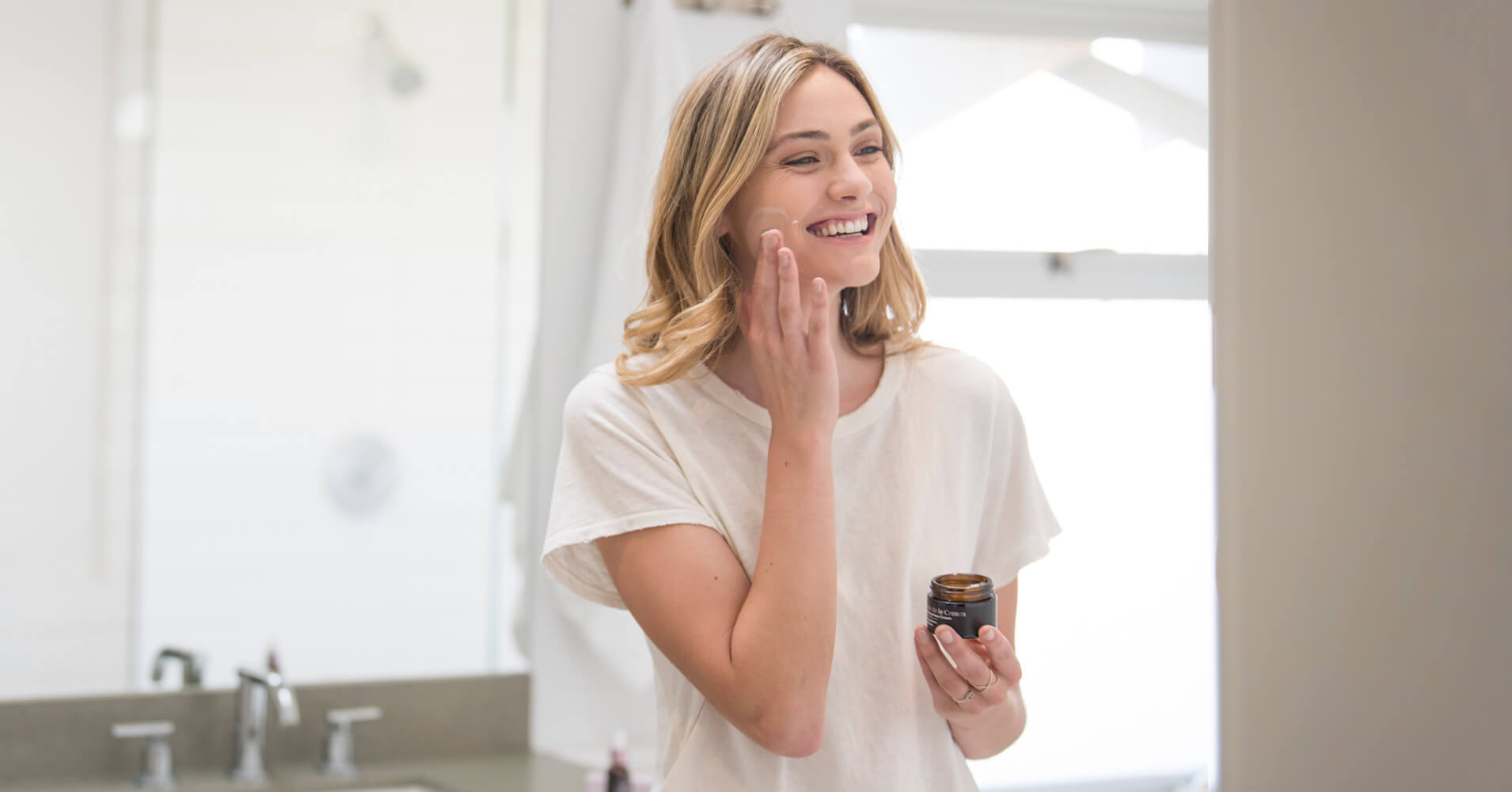 Easy skin care routine - woman in bathroom