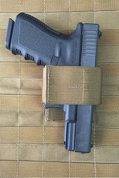 MOLLE Safe Panel Pistol Holster.jpg