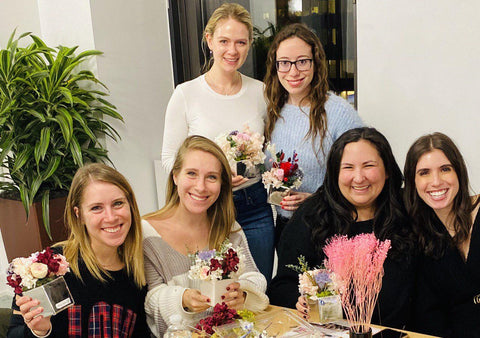fun corporate bonding event with preserved flowers and roses