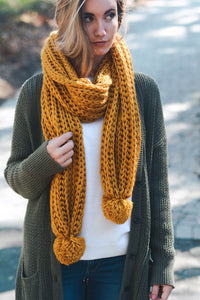 MUSTARD KNIT SCARF WITH POM DETAIL