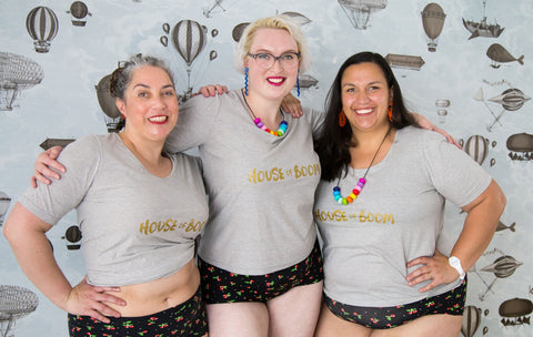 "three babes in plus-size grey cotton t-shirts with ""HOUSE OF BOOM"" screenprinted on them"