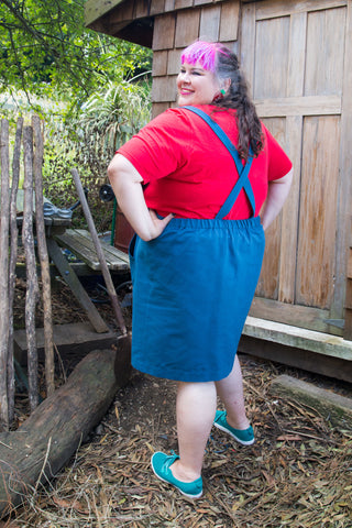 a fat babe in a cotton pinafore with crossed straps