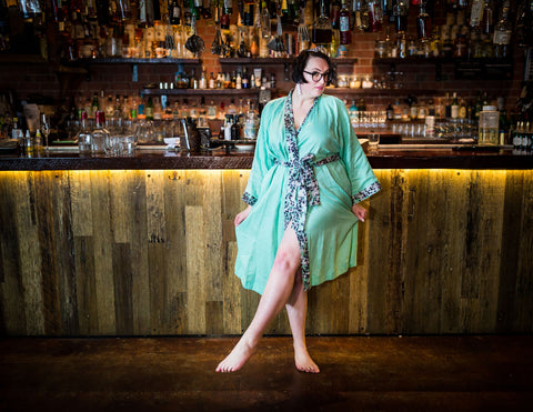 alex wears a mint green plus size robe