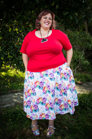 a plus size cotton skirt with a rainbow zebra print on it