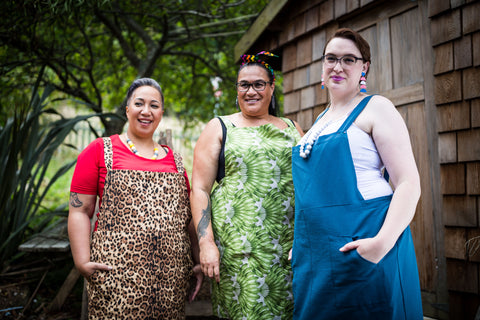 three fat babes in plus size cotton pinafore dresses in leopard print, leaf print and teal