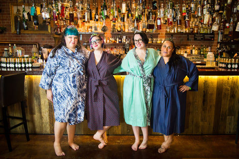 four girls in plus size robes