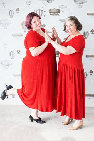 Carma and Kris in red dresses