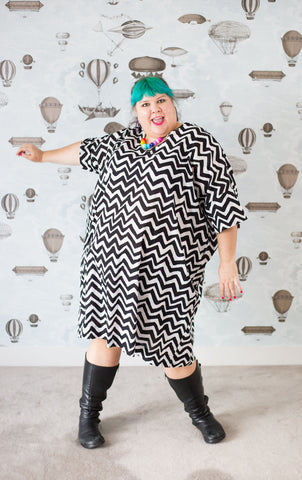 Joanna in a zig zag cotton plus-size sack dress with pockets