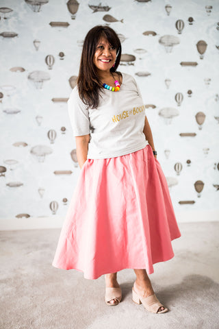 Woman in a blush skirt