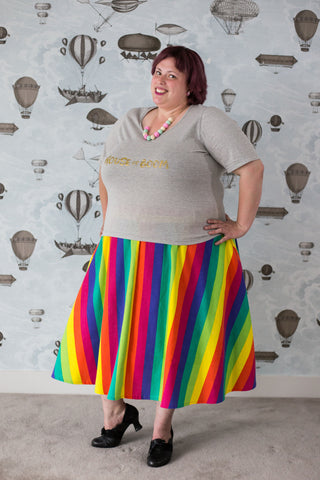 Carma in a rainbow cotton skirt with pockets