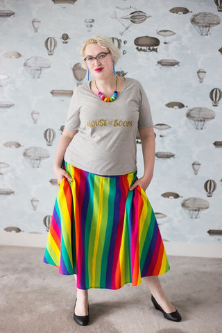 Alex in a tshirt and rainbow skirt