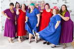 lots of babes in plus size cotton dresses in bright colours