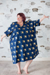 Plus-size sack dress in navy with a gold cat print