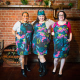 Fat babes wearing orchid print plus size pinafores
