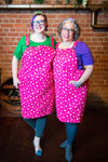 Fat babes in pink star print pinafores