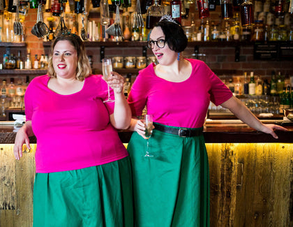 fat babes in pink t-shirts and green skirts