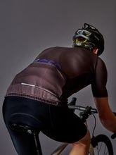 Load image into Gallery viewer, Jenson Button in our LÉGER DTLA - cycling jersey back view with a pocket