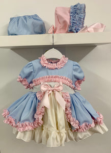 Myla Dress in various colours (sample shows Blue/Pink Frills)